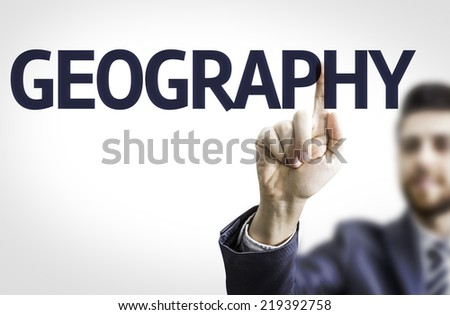 Business man pointing to transparent board with text: Geography - stock photo