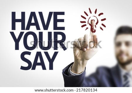 Business man pointing to transparent board with text: Have Your Say - stock photo
