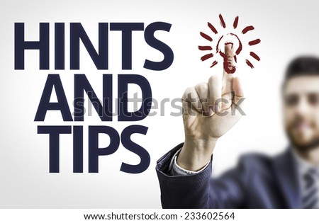 Business man pointing to transparent board with text: Hints and Tips