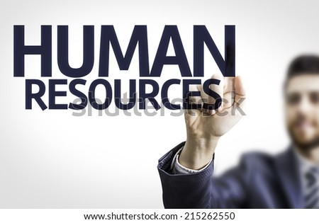 Business man pointing to transparent board with text: Human Resources - stock photo