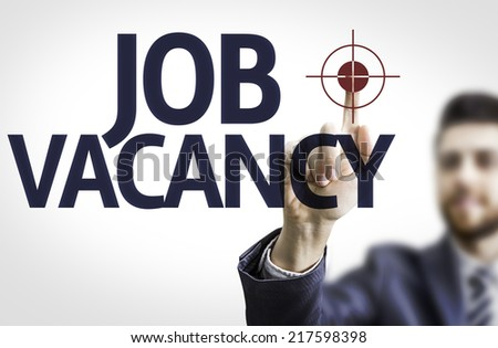 Business man pointing to transparent board with text: Job Vacancy - stock photo