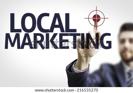 Business man pointing to transparent board with text: Local Marketing - stock photo