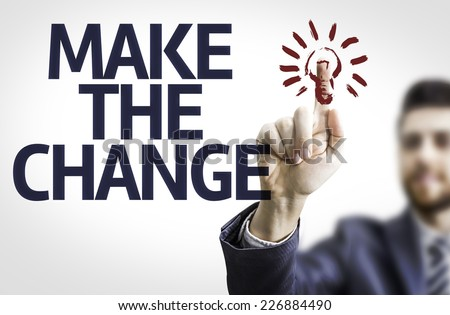 Business man pointing to transparent board with text: Make the Change - stock photo