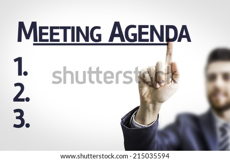 Business man pointing to transparent board with text: Meeting Agenda  - stock photo