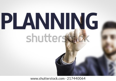 Business man pointing to transparent board with text: Planning - stock photo