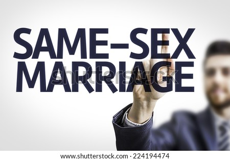 Business man pointing to transparent board with text: Same-Sex Marriage - stock photo