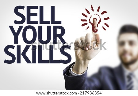 Business man pointing to transparent board with text: Sell Your Skills - stock photo