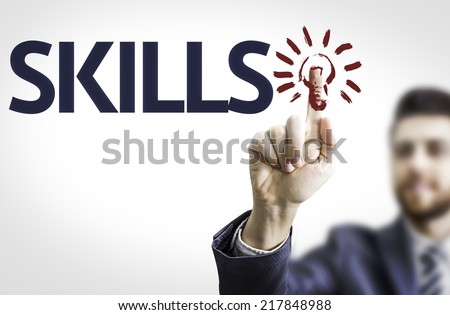 Business man pointing to transparent board with text: Skills