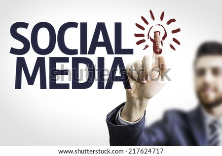 Business man pointing to transparent board with text: Social Media