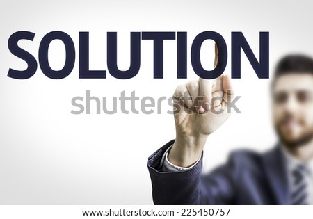 Business man pointing to transparent board with text: Solution