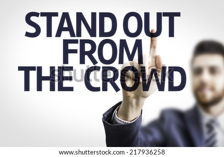 Business man pointing to transparent board with text: Stand Out From The Crowd  - stock photo