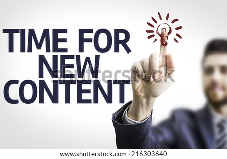 Business man pointing to transparent board with text: Time For New Content - stock photo
