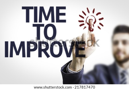 Business man pointing to transparent board with text: Time To Improve