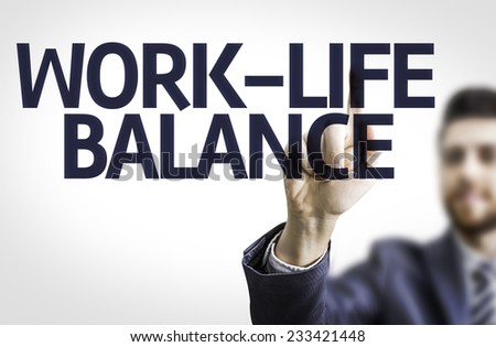 Business man pointing to transparent board with text: Work-Life Balance - stock photo