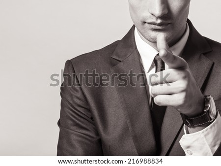 Business man pointing with his finger - stock photo