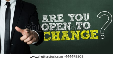 Business man pointing with the text: Are You Open to Change? - stock photo