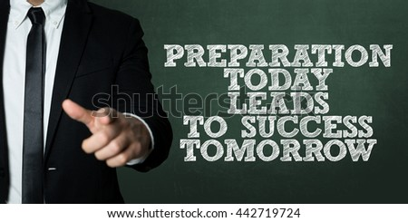 Business man pointing with the text: Preparation Today Leads To Success Tomorrow - stock photo