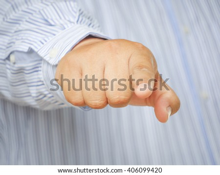 business man points his finger at you - stock photo