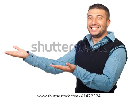 Business man  points his open empty palms to copy space  and making a presentation or invite  someone  isolated on white background - stock photo