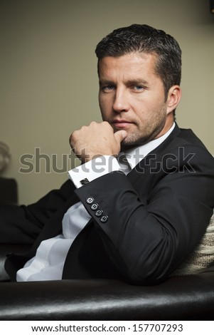 business man portrait against a dark background