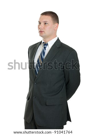 Business man portrait with hands behind back looking away isolated on white - stock photo