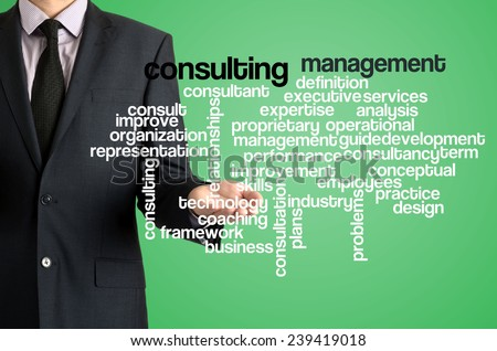 Business man presenting wordcloud related to consulting management on virtual screen - stock photo