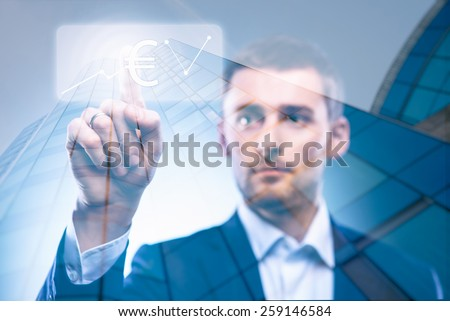 business man press dollar button in air - stock photo