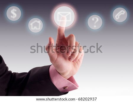 Business man pressing a digital button.