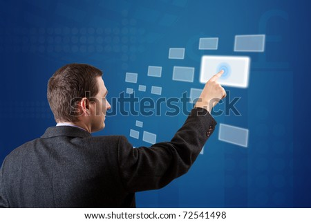 business man pressing a digital button - stock photo