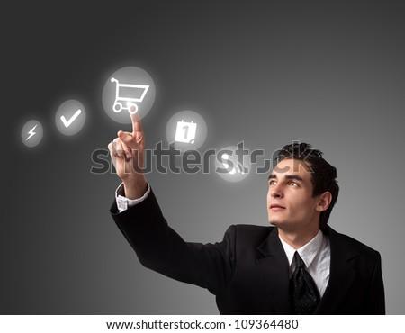 business man pressing a shopping cart button - stock photo