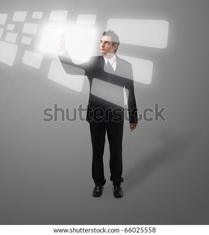 Business man pressing a touchscreen button, futuristic digital technology - stock photo