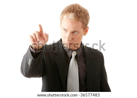 Business man pressing an abstract touchscreen button isolated - stock photo