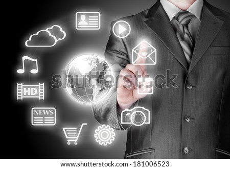 Business man pressing an icon in air
