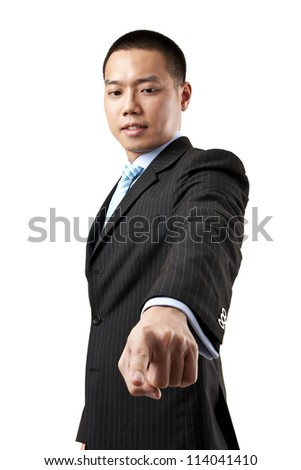 Business man pressing an imaginary button over white background - stock photo