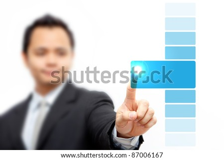 Business man pressing blue button