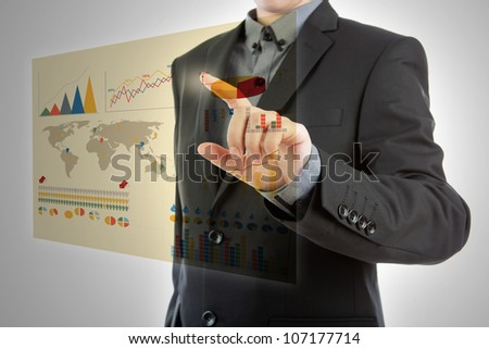 Business man pressing high tech type of modern graph on a virtual background - stock photo