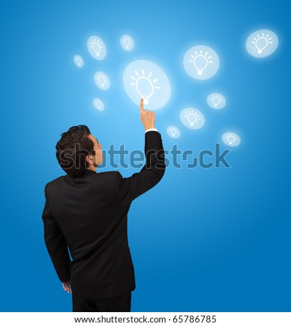 business man pressing lightbulp button - stock photo