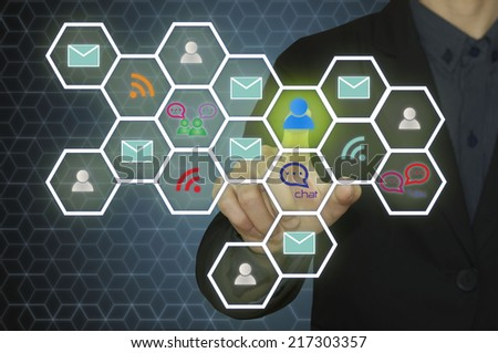 Business man pressing mobile app icons