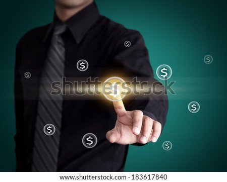 Business man pressing money icon - stock photo