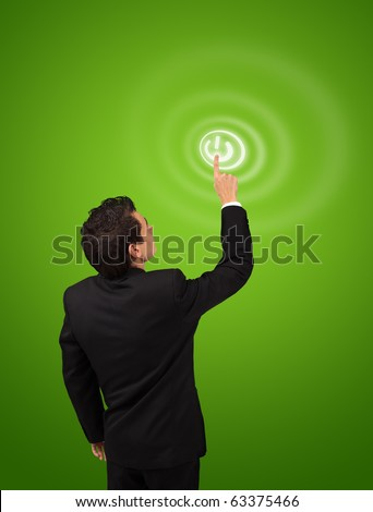 business man pressing ON / OFF button - stock photo