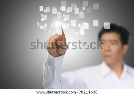 Business Man Pressing or Pushing on touch screen button or interface - stock photo