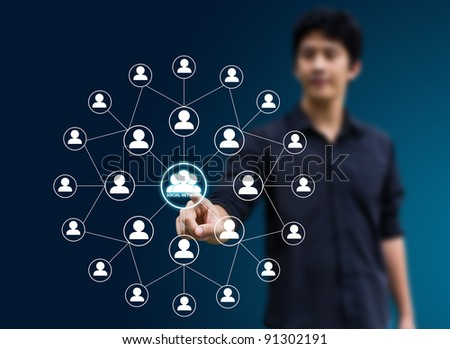Business man pressing Social network icon - stock photo