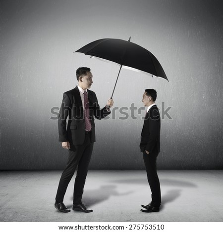 Business man protect smaller himself. Self guard conceptual