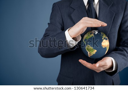Business man protecting the Earth. Sustainable responsible business, eco-friendly business, global business concepts. Move heaven and earth idiom.