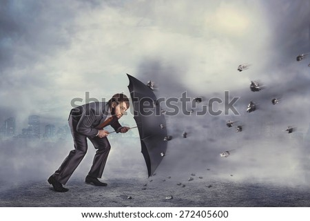 Business man protects himself from the crisis - stock photo