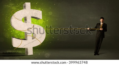 Business man pulling a big green dollar sign concept on background - stock photo