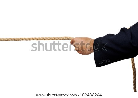 Business man pulling a rope isolated on white background in studio - stock photo