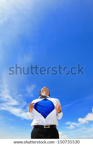 Business man pulling his t-shirt open, showing a superhero suit underneath his suit - stock photo