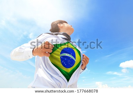 Business man pulling his t-shirt open, showing Brazil national flag - stock photo