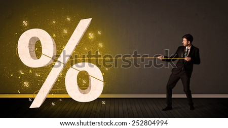 Business man pulling rope with big procent symbol sign concept on background - stock photo